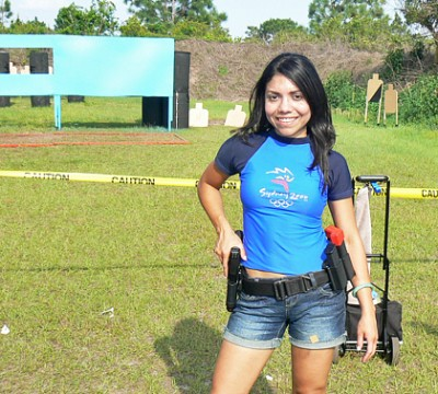 Top Shot Season 4 Competitor Gabby Franco taking a shooting break in her 2000 Olympic souvenir. Photo: Gabby Franco