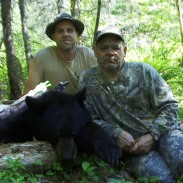 Rex Holmes, Jr., (front) and Taxis River Guide Jamie Durling with Rex's bear.
