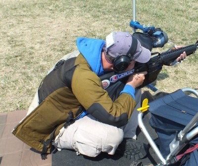 Jeff Lindblon of Rockport, Missouri shoots sitting with a conventional AR-15 service rifle