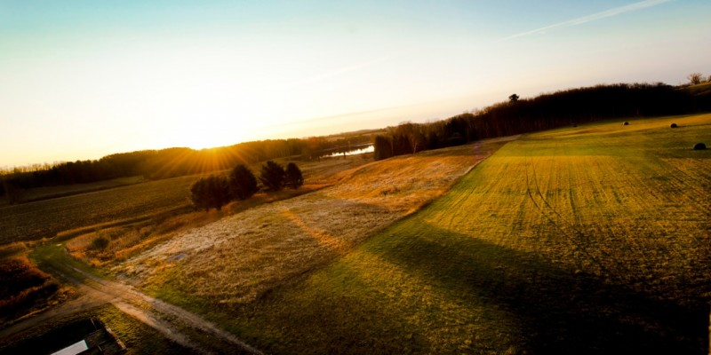 Sunrise over Timber Ridge Ranch in Ellsworth, Michigan by Lena Lee