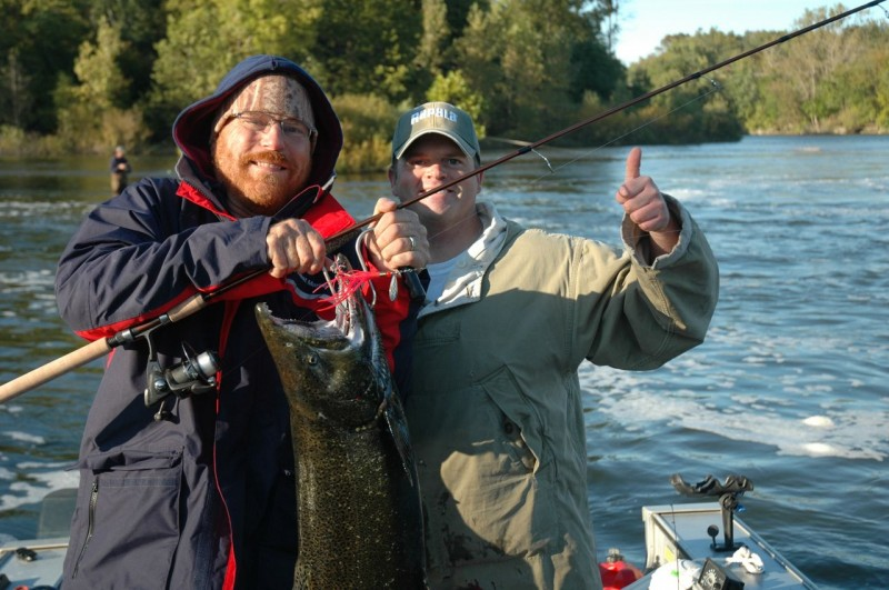 Writer Dave Mull holds a 17-pound St. Joseph River king hooked on a Luhr Jensen Coho Bolo with guide Scott Crouch. Photo by Kathy Terpstra