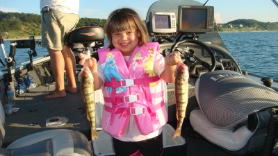 Samantha Rudlaff displays a pair of dandy Lake Michigan perch caught fishing with her father Elmer.
