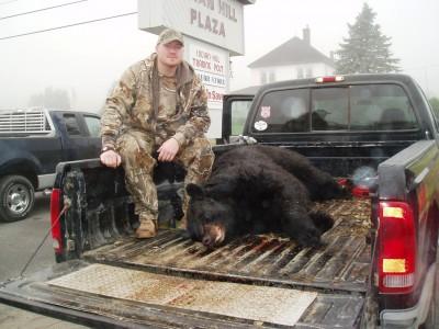 Knox with his 669-pound bear. Image courtesy of John Longergan.
