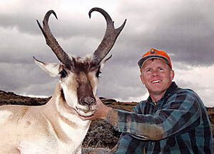 Jared J. Mason with a trophy pronghorn taken in Carbon County, Wyoming, in 2004. The buck has a final score of 84-6/8 points.