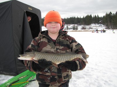 Alex Ellis of Plains shows off the 4.85-pound pike that took first in the largest pike category at today's Sunriser Lions Ice Fishing Derby at Smith Lake west of Kalispell