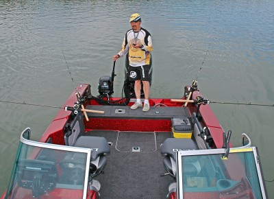 Lund's unique Sport Trak system allows you to position rod holders anywhere in the boat, without having to drill any holes to install them. Here, Hall of Fame fisherman Ted Takasaki is handling the controls for he and a fishing partner, who snapped the photo. They are each allowed two rods, which lets them set up a spread of lines and test various presentations.