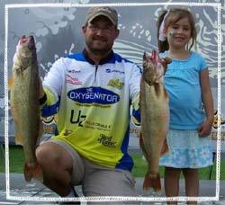 Matt Davis on the Masters Walleye Circuit stage with some nice walleyes and his daughter, Ashley.