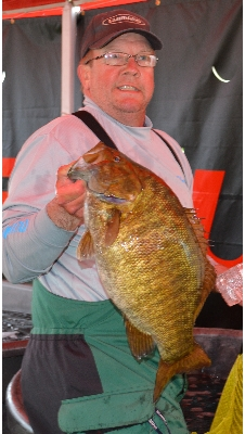 Schneider's smallmouth tipped the scales at 8.45-pounds - the largest smallie ever weighed in since the event started 23 years ago.