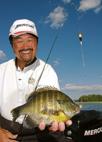 Ted Takasaki with a beautiful hot-weather bluegill, caught during a time when many anglers complain about the slow fishing. The heat of summer can produce fast action on nice panfish, with bonus catches, by following the recipe laid out here.