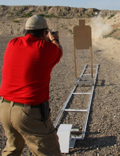 The cardboard target riding the trolley falls toward the shooter when it reaches the end of the travel.
