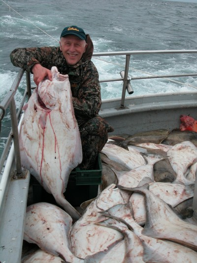 Author with boatload of halibut caught on charter out of Homer.