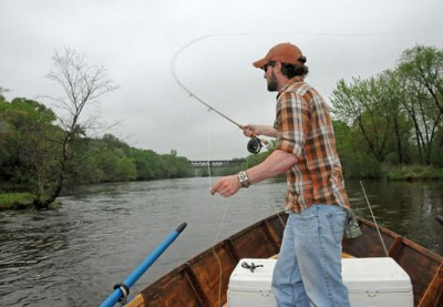 Dave Bakken casts a fly while drift fishing the Chippewa River.