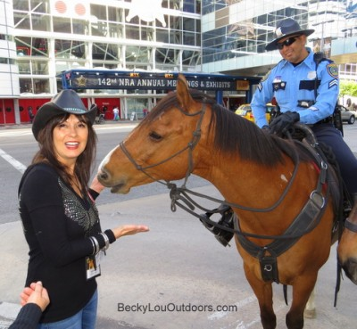 "Outside of the NRA Convention, Vinson the Police Horse demands another ""well deserved"" peppermint by nibbling at Becky Lou's hands and shirt sleeve!"