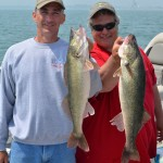 Keith Eshbaugh and Captain Paul Doute show two of the biggest walleyes of Monday's excursion in the Michigan waters of Lake Erie.