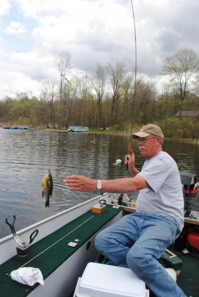 Denny Hettig hauls in a shallow-water 'gill.