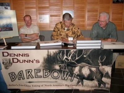 Author and archer Dunn at a book signing event with the father-and-son artist duo of Hayden and Dallen Lambson. The Lambsons created spectacular custom-made art for the book.