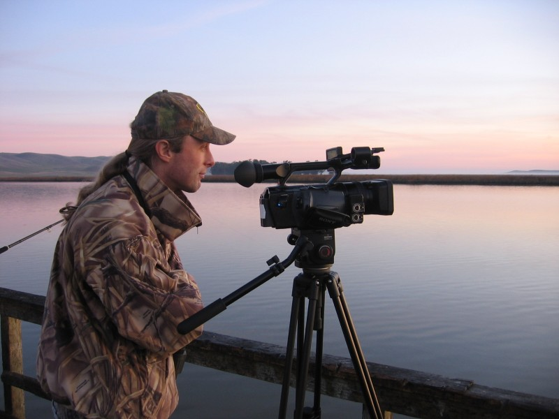 The author's son watching for wildlife while filming. Developing your visual awareness can improve your skills as an outdoorsman and enhance your quality of life.