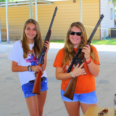 Anxious with Anticipation!! Jade (L) has never shot before, and it has been a long time since Maddie (R) has pulled a trigger. They are getting some hands on time with a few rifles before we headed for the range to shoot for Take Your Daugher to the range day!!