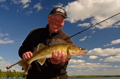"""""""When walleyes key on shiners in lakes with big, shallow flats, they move up into water less than 4-feet deep. They're so shallow you can actually see them,"""" said Sundin."""