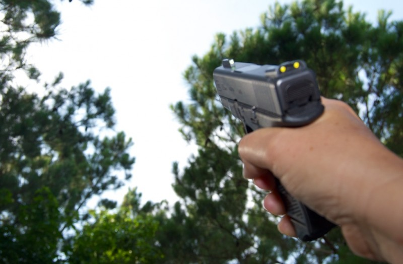 Un-natural point of aim handgun