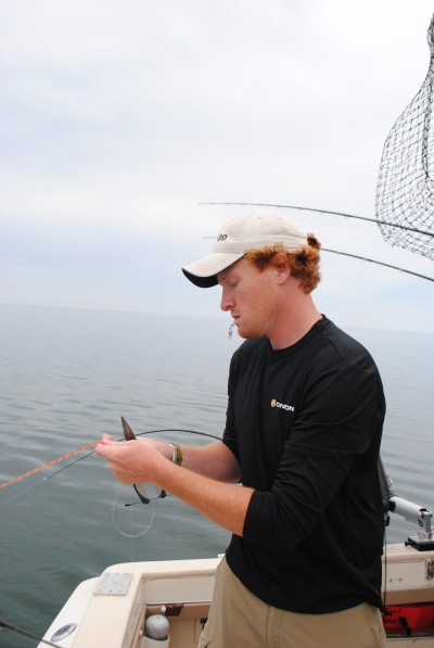 Hunter Engel ties up a trolling rig.