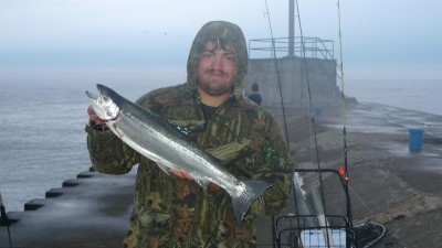 Clyde Brazie of Hartford, Michigan, was one of the successful anglers Tuesday and shows one of two steelhead he caught on shrimp below a bobber.