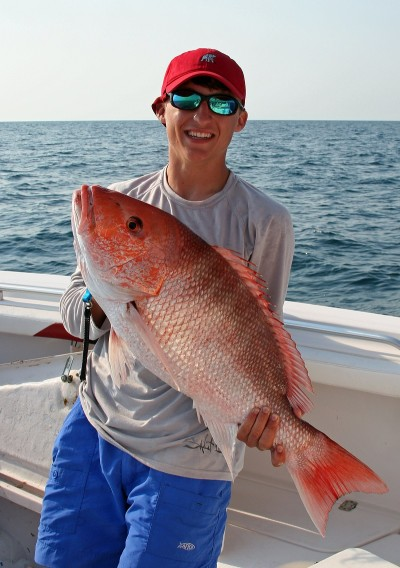 Brandon Jordan of Mobile shows off another big red snapper that have become commonplace for anglers off the Alabama Gulf Coast.