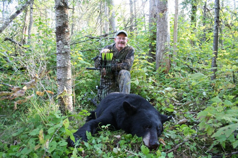 """The author with one of three bears that were bagged in a short time at the bait location named the """"Beaver Pond Bait."""""""
