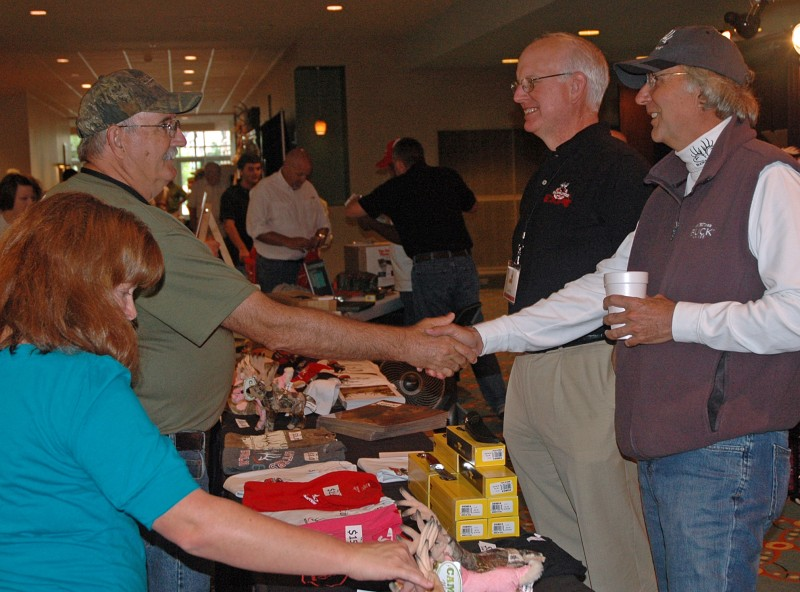Buckmasters CEO and founder Jackie Bushman, right, greets a fan during the Buckmasters Expo last weekend at the Montgomery Convention Center.