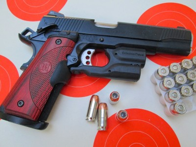 This is one swell setup. Crimson Trace Master Series Lasergrips and the Crimson Trace Lightguard for 1911s.