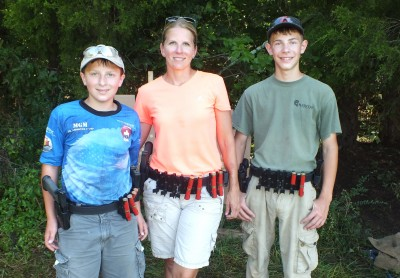 A shooting family: Becky Yackley, with Tim right) and Sean (left), at stage one at the AR15.com Rockcastle 3 Gun.