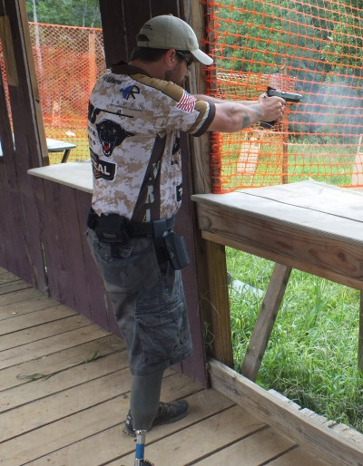 Chris Fleming shoots stage four with his pistol.