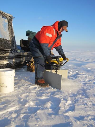 A DIY slush board can help keep you dry on the ice.