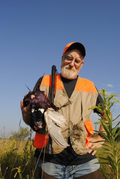 Tim Somerville shows off a rooster.
