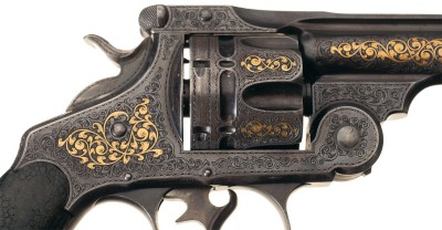 This close up of a gold inlaid Smith & Wesson .44 revolver shows exquisite detailing by master engraver Gustave Young.