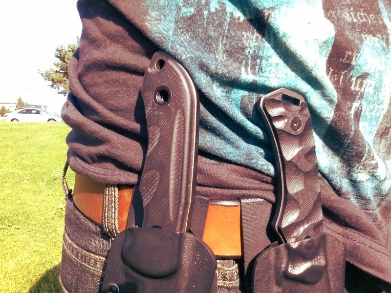 Here we see two Schrade knives in a symbiotic relationship with a belt.