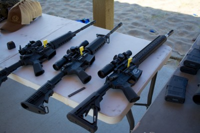 The Media Day range at the Crimson Trace Midnight 3 Gun Invitational displayed especially good manners. Note all guns pointed down range, tables with chambers open and chamber flags in place.