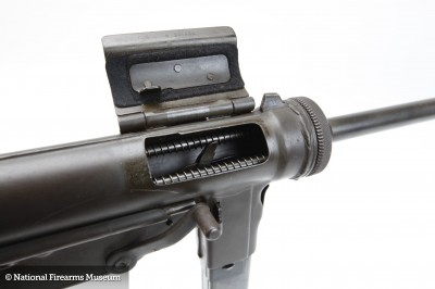 The M3 fires from an open bolt. This means a big hunk of metal has a firing pin welded to it. It's held back with pressure from an even bigger spring. Pulling the trigger releases the bolt, which strips a round from the magazine, shoves it in the barrel, and discharges it.