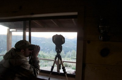Guide Mike White glasses for elk in the dawn of a cool day on the first morning of the hunt.