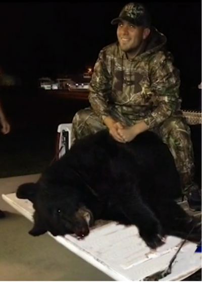Heath Smith with his record-breaking bear.