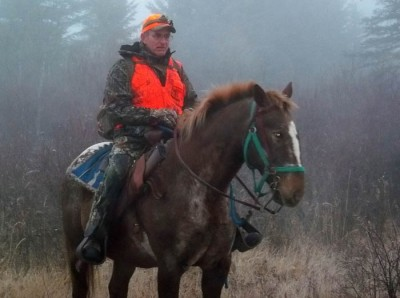 The author rides out to hunt deer in Manitoba's Duck Mountain Provincial Forest.