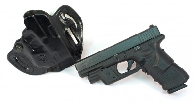 Here's a Glock 31 with Crimson Trace Lightguard and Lasergrips. The Lightguard-ready holster is a DeSantis Speed Scabbard.
