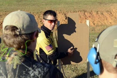 Staff Sgt. Daniel Horner, U.S. Army Marksmanship Unit, explains shots on a target Oct. 26 during the 6th annual USAMU Action Shooting Junior Clinic at Krilling Range.