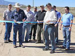 Representatives of the Arizona Game and Fish Department, National Wild Turkey Federation, and Mule Deer Foundation cut a blue ribbon Friday marking acquisition of permanent public right-of-way to Frye Mesa Road.