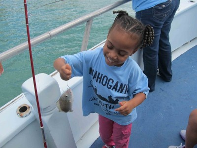 Youngest angler shows off her catch