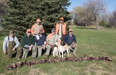 Part of the hunting party with their harvests.