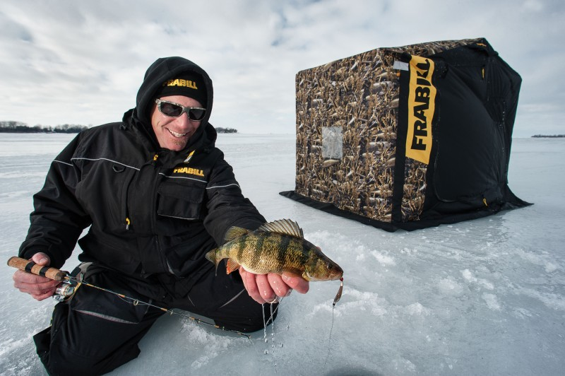 Jigging spoons are Joe Balog's go-to all winter long. And this jumbo perch came utilizing Humminbird sonar coupled with an Aqua-Vu underwater camera to get his lure in the fish's face.