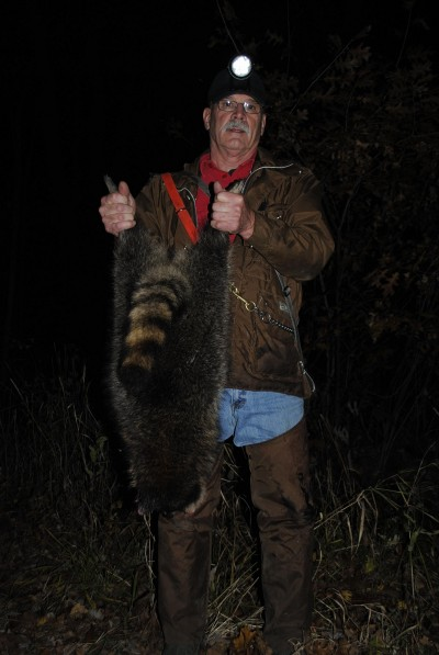 Jim Zimmerman shows off a raccoon.