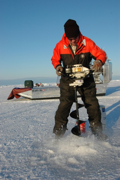 Augers are needed to get through the ice and to the fish; power augers make the job easier when the ice is thick.