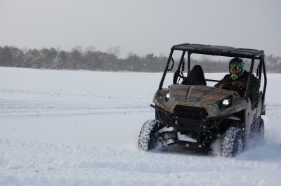It'd take a lot of snow to stop most side-by-sides, like this Kawasaki Teryx. Image by Brandie Sigler.